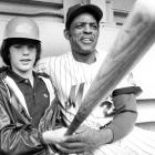 Mays and John F. Kennedy, Jr., pose for a photo outside Shea Stadium in 1972. Mays had been traded to the Mets less than three weeks earlier.