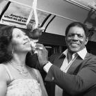 """Mays wipes sweat from his wife's face as they ride the """"A"""" train to the former sight of the Polo Grounds, the long-time home of the New York Giants. The Colgate women's games paid tribute to Mays on Aug. 2, 1979, the day this photo was taken. He was inducted into the Hall of Fame three days later."""