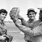 Mets outfielder Lee Mazzilli and manager Joe Torre listen to Mays talk about outfield defense. The Mets brought in the 12-time Gold Glove winner to work on Mazzilli's defense and teach him the famed basket catch.
