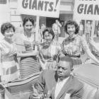 Mays rides in a convertible during a parade down Montgomery Street on Opening Day of the Giants' first season in San Francisco.