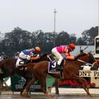 Ruler On Ice (right) returned $51.50, $26 and $13.60. Stay Thirsty, owner Mike Repole's second-best 3-year-old behind the sidelined Uncle Mo, paid $19.40 and $10.80.