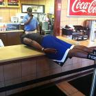 To the delight of one lucky employee, Howard planks on the counter of Zaxby's.