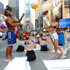 Why SI.com is happy to be based in midtown Manhattan: On any given day, such as Thursday, June 9, a flash mob can turn Times Square into a summer sports paradise.