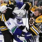 Bruins goalie Tim Thomas and defenseman Dennis Seidenberg tried to surgically remove the head of Canucks left wing Alex Burrows during a particularly contentious Game 4 in Boston.