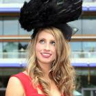 A statuesque blonde will inevitably attract pigeons and other flighted fowl, as you can see from this full-color photograph taken at England's Ascot Racecourse.