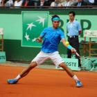 Rafael Nadal plays a return to Roger Federer.