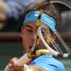 Nadal returns to Federer early in Sunday's match.