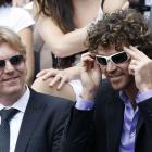 Former French Open champions Jim Courier (left) and Gustavo Kuerten (right) joke before Sunday's Nadal-Federer match.