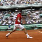 Roger Federer hits a return to Rafael Nadal.