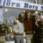 Borg stands outside of his sports store with his parents.