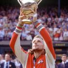 Borg lifts the Wimbledon trophy for the fourth time after winning the 1979 title.