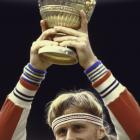 Borg lifts the Wimbledon trophy after outlasting McEnroe in the 1980 final.