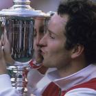 McEnroe kisses the trophy after winning the 1984 U.S. Open.