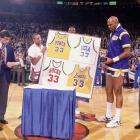 The New York Knicks selected Jackson with the 18th overall pick in the 1987 draft and he went on to win Rookie of the Year honors. In this photo, Jackson helps pay tribute to the retiring Kareem Abdul Jabbar by giving him framed  jerseys from his former teams.