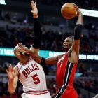 """Bulls forward Carlos Boozer and Heat forward Chris Bosh were members of the high-profile NBA free-agent class last summer. When their teams matched up in the Eastern Conference Finals, Boozer refused to mention Bosh by name, instead saying that the Heat have """"two great players."""" Bosh proceeded to thoroughly outplay Boozer in the series, putting his money where the Bulls forward's mouth was."""