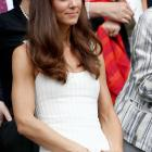 Kate, wearing an off-white, knee-length dress with tiered layers and embroidered straps, stands during the fourth-round match between Tsvetana Pironkova and Venus Williams.