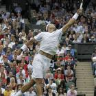 Spain's Rafael Nadal extends for a return during his first-round match with Michael Russell of the U.S.