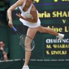 Maria Sharapova serves to Sabine Lisicki during their semifinal.