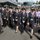 Security staff hold back the crowd as the gates open Thursday at Wimbledon.