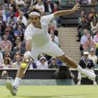 Roger Federer returns a shot to Kazakhstan's Mikhail Kukushkin.