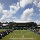 Slovakia's Karol Beck and Argentina's Carlos Berlocq play their first-round match on Day 2 of the Wimbledon Championships.