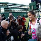 Great Britain's Laura Robson leaves the court after scoring her first-ever main-draw victory at Wimbledon over Germany's Angelique Kerber.