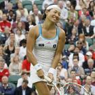 Kimiko Date Krumm reacts during her match against Venus Williams.