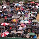 Fans wait out the rain on Day 3 at Wimbledon.