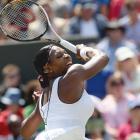 Serena Williams returns to Simona Halep during Thursday's match.
