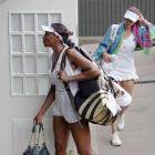 Venus Williams (front) and Tsvetana Pironkova (rear) leave Centre Court after their fourth-round match.