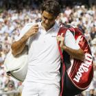 Roger Federer leaves the court after losing to Jo-Wilfried Tsonga.