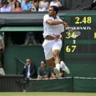 France's Jo-Wilfried Tsonga hits a return during Wednesday's quarterfinal match against Switzerland's Roger Federer.