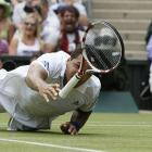 Jo-Wilfried Tsonga dives across the court to reach for a shot during his match against Roger Federer.