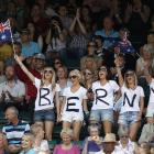 Fans of Bernard Tomic stand on Court 1 before his quarterfinal match against Novak Djokovic.