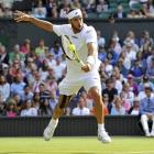 Feliciano Lopez of Spain hits a return to Andy Murray of Great Britain during their quarterfinal match.