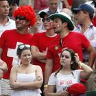 Fans of Roger Federer watch Wednesday's match on Centre Court.