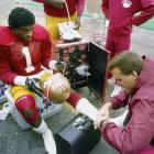 Sanders is shown here as a Florida State Seminole, getting his ankle taped before their 1988 Sugar Bowl matchup with Auburn. Sanders was a third-team All-America in '88 and often saved his best performances for the biggest stages. He had three interceptions in bowl games over his four-year career.