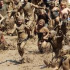 A recipe for happy kids: mix 180 metric tons of fill dirt with 76,000 litres of water and add tots. Herewith, the result in the annual event at Nankin Mills recreation complex in Westland, Michigan.