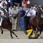 Jockey Giuseppe Zedde found this year's annual bareback competition in Siena, Italy to be a bit of a drag...