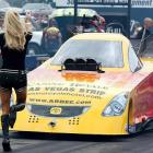Even seasoned funny car pilots can't escape commentary from the spouse about their driving, as seen in this startling photograph taken at Summit Racing Equipment Motorsports Park in Norwalk OH.