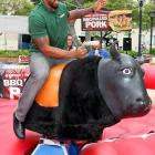 With NFL players locked out, the Houston Texans pigskin hauler took the bull by the proverbial horns at the SUBWAY All-Star BBQ in Los Angeles. As Mr. Foster tried to steer this hunk of beef onto a bun, the fast food chain launched its BBQ Pulled Pork sub -- isn't pulled pork actually pulled hamstrings? Just wondering -- and raised funds for victims of recent natural disasters in western Alabama.
