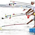 Either these gentlemen are fishing for compliments from Eva Risztov of Hungary or she's so Hungary she had to stop at the feeding pontoon during the women's 10km event in Shanghai, China. You decide.
