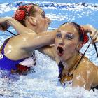 Natalia Ishchenko and Svetlana Romashina of Russia flawlessly executed the always-difficult dual hydrowedgie maneuver during the preliminary round of the synchronized swimming duets free routine (meaning no admission charge, we assume) in Shanghai.