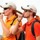 Two fans of duffer Miguel Angel Jimenez made like their hero, who has been known to enjoy a fine cheroot from time to time.