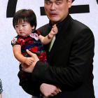Proud papa appeared to detect a dirty diaper while announcing his retirement from the NBA at a press conference in Shanghai on July 20.