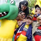 We believer this is a photo of the Tour de France winner in the crowd at one of those crocodile wrestling matches in Bangkok, but we could be wrong and often are.