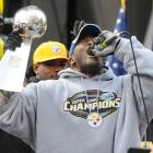Harrison celebrates the Super Bowl XLIII win at a parade in Pittsburgh in 2009. While Harrison was in contention for the MVP award, Santonio Holmes took the honors with his last-second touchdown catch to capture the 27-23 victory against the Cardinals.