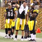 "Harrison talks with Roethlisberger and wide receiver Hines Ward during a game against the Buffalo Bills in 2009. In a recent interview with  Men's Journal , Harrison said that Roethlisberger ""should stop trying to act like Peyton Manning... you just get paid like he does."""