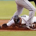Emilio Bonifacio beats catcher Ronny Paulino's throw to second on a steal attempt in the first inning of the Mets-Marlins game on July 22. Bonifacio's steal led to him scoring on a grounder, but the Marlins would need more after falling 7-6.