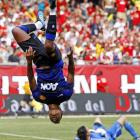 Manchester United's Nani performs an acrobatic flip while Chicago Fire goalie Jon Conway lies on his back after Nani beat him in the second half of a friendly between the teams. The visiting Manchester United won 3-1.